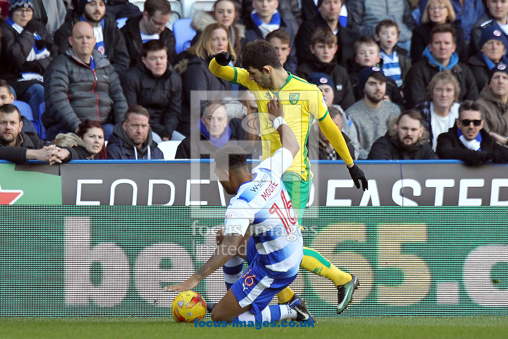 Liam Moore of Reading and Nelson Oliveira of Norwich in action during the Sky Bet Championship match at the Madejski Stadium, Reading<br /> Picture by Paul Chesterton/Focus Images Ltd +44 7904 640267<br /> 26/12/2016