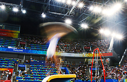 France's Thomas Bouhail competes on the vault of artistic gymnastics apparatus finals during the Olympic games in Beijing, China, 18 August 2008. Blanik won the gold for the event. Bouhail won the silver for the event.