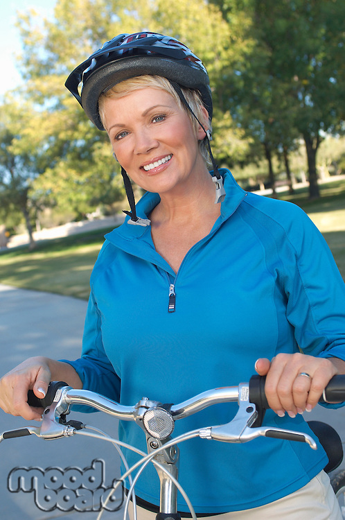 Senior woman on bicycle, portrait