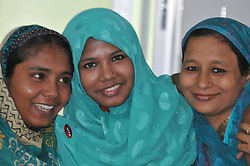 59784314  <br /> Reshma (C), a young female garment worker, poses for photos with her sisters in a hospital in Savar on the outskirts of Dhaka, Bangladesh, June 6, 2013. Miraculous Bangladeshi building collapse survivor Reshma will join Starwood Hotels and Resorts Worldwide, one of the top global hotel chains, as an ambassador, officials said Thursday. Eight-storey building Rana Plaza collapsed in Savar on the outskirts of the capital Dhaka on April 24, leaving at least 1,127 dead, June 6, 2013 .UK ONLY