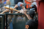PHOENIX, AZ - APRIL 04:  Eduardo Nunez #10 of the San Francisco Giants signs autographs for fans prior to the MLB game the against the Arizona Diamondbacks at Chase Field on April 4, 2017 in Phoenix, Arizona.  (Photo by Jennifer Stewart/Getty Images)