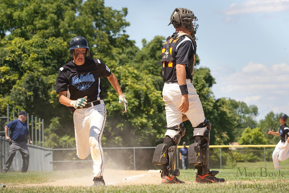 Pennsylvania's Eric Walkowiak scores Pennsylvania's 2nd run during the winner take all final of the Eastern Regional Senior League tournament between Pennsylvania and Maryland held in West Deptford on Thursday, August 11.