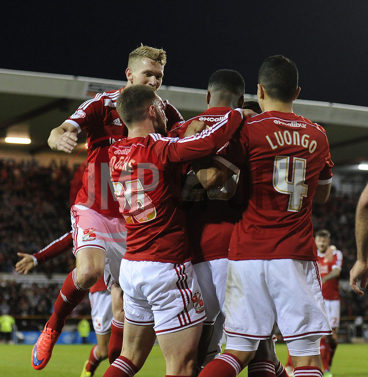 Swindon Town's Jonathan Obika celebrates with his team mates after scoring a goal - Photo mandatory by-line: Dougie Allward/JMP - Mobile: 07966 386802 - 11/05/2015 - SPORT - Football - Swindon - County Ground - Swindon Town v Sheffield United - Sky Bet League One - Play-Off