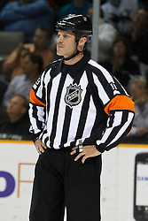 November 9, 2010; San Jose, CA, USA;  NHL referee Gord Dwyer (19)during the first period of the game between the San Jose Sharks and the Anaheim Ducks at HP Pavilion.  The Ducks defeated the Sharks 3-2 in overtime. Mandatory Credit: Jason O. Watson / US PRESSWIRE
