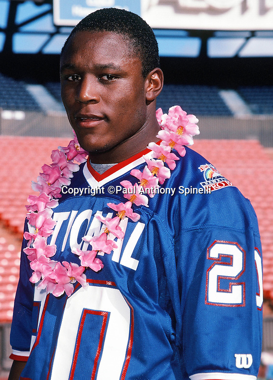 Detroit Lions running back Barry Sanders (20) poses for a photo with a lei on photo day during the week of the 1990 NFL Pro Bowl between the National Football Conference and the American Football Conference on Jan. 30, 1990 in Honolulu. The NFC won the game 27-21. (©Paul Anthony Spinelli)