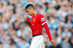 Chris Smalling of Manchester United looks dejected as he leaves the pich after he is shown a red card by referee Michael Oliver for a challenge on James Milner of Manchester City - Photo mandatory by-line: Rogan Thomson/JMP - 07966 386802 - 02/11/2014 - SPORT - FOOTBALL - Manchester, England - Etihad Stadium - Manchester City v Manchester United - Barclays Premier League.