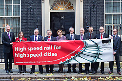 © licensed to London News Pictures. London, UK 21/11/2013. City leaders of the UK's ten largest cities outside of London (Birmingham, Bristol, Leeds, Liverpool, Manchester, Newcastle, Nottingham, Sheffield, Glasgow, Edinburgh) posing on Downing Street before delivering a declaration of support for HS2 to Prime minister David Cameron on Thursday, November 21, 2013. Photo credit: Tolga Akmen/LNP