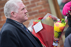 © Licensed to London News Pictures . 11/11/2012 . Lytham Park Crematorium , UK . A man carrying flowers with a tribute from BNP leader Nick Griffin MEP at the funeral of Harold Percival . Hundreds of strangers at the funeral of World War Two veteran Harold Jellicoe Percival today (Monday 11th November 2013) . The funeral is timed to coincide with the First World War armistice , the 95th anniversary of which is at 11am today (Monday 11th November 2013) . The RAF Bomber Command veteran died in his sleep on 25th October 2013 , aged 99 , at Alistre Lodge Nursing Home in St Annes , Lancashire , with no immediate family . Photo credit : Joel Goodman/LNP