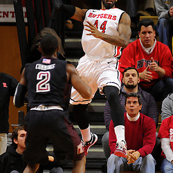 J.J. Moore #44 of the Rutgers Scarlet Knights jumps to keep the ball in bounds during the first half of Rutgers men's basketball vs Temple Owls in American Athletic Conference play on Jan. 1, 2014 at Rutgers Louis Brown Athletic Center in Piscataway, New Jersey.