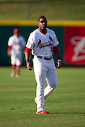 Xavier Scruggs (15) of the Springfield Cardinals warms up in the outfield prior to a game against the Arkansas Travelers at Hammons Field on July 24, 2012 in Springfield, Missouri. (David Welker/Four Seam Images)
