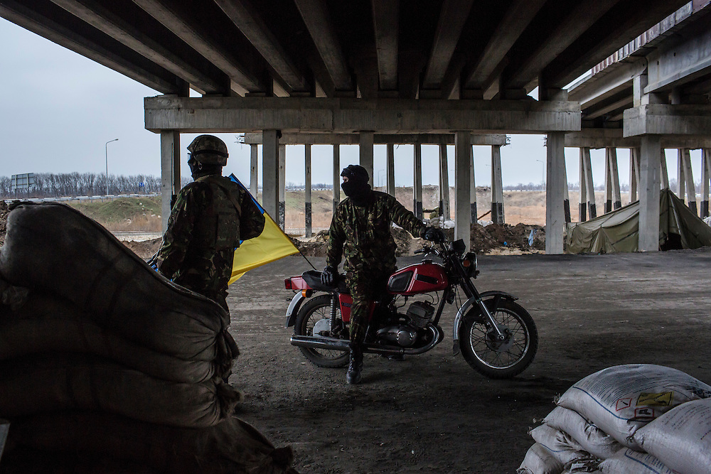PERVOMAISKE, UKRAINE - NOVEMBER 17, 2014: Members of the 5th platoon of the Dnipro-1 brigade, a pro-Ukraine militia, at their post underneath a bridge in Pervomaiske, Ukraine. CREDIT: Brendan Hoffman for The New York Times
