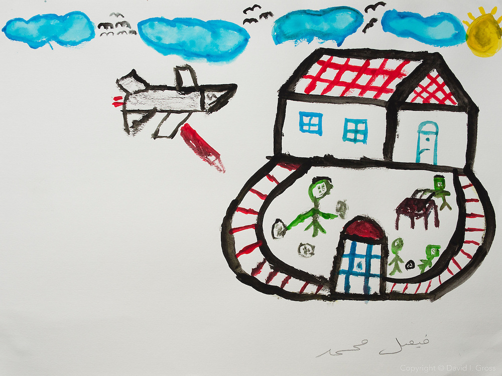 During the war: a plane drops bombs on our house. Drawing by a 10 year old Syrian boy. (Topic for session: draw your impression of life before, during and after the war.)