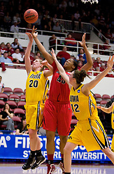 March 20, 2010; Stanford, CA, USA; Iowa Hawkeyes forward Kelly Krei (20) and center Morgan Johnson (12) fight Rutgers Scarlet Knights center Rashidat Junaid (43) for a rebound during the first half in the first round of the 2010 NCAA womens basketball tournament at Maples Pavilion. Iowa defeated Rutgers 70-63.