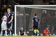 Dejected Scotland  players as Russia celebrate their second goal 1-2 during the UEFA European 2020 Qualifier match between Scotland and Russia at Hampden Park, Glasgow, United Kingdom on 6 September 2019.