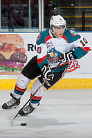 KELOWNA, CANADA - MARCH 23: Nick Merkley #10 of the Kelowna Rockets skates with the puck against the Tri-City Americans on March 23, 2014 at Prospera Place in Kelowna, British Columbia, Canada.   (Photo by Marissa Baecker/Shoot the Breeze)  *** Local Caption *** Nick Merkley;