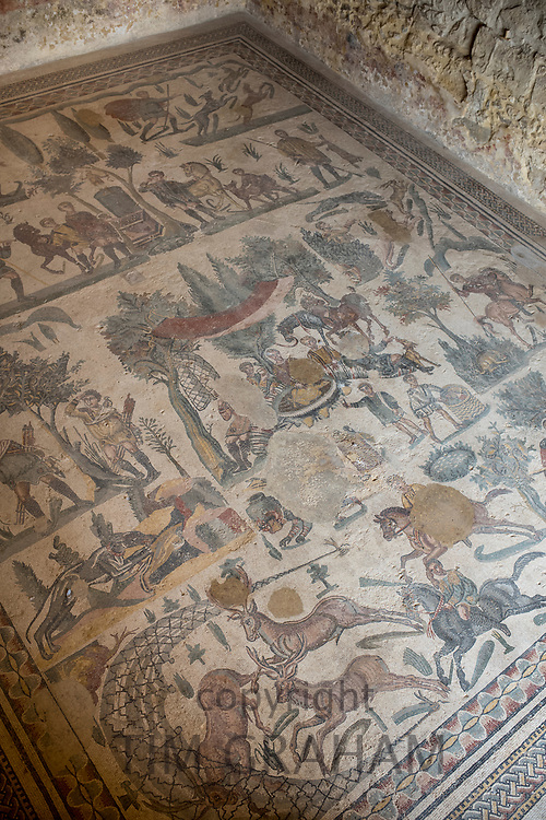 Famous mosaics and mosiac art of hunting scenes at ancient Roman Villa del Casale, Piazza Armerina, Sicily, Italy