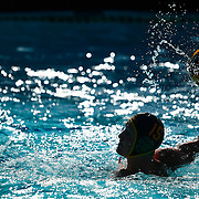 A player moves the ball in the water during the 2016 Orange Empire Conference Water Polo Championships at Saddleback College in California on Friday.
