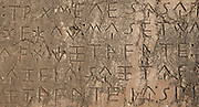 Detail of inscription on the Xanthian Obelisk, 425-400 BC, a large monolithic block on a 2-stepped krepis, with a trilingual inscription on all 4 sides, in Ancient Greek, Lycian and Milyan (the last two are Anatolian languages), giving important information about the period'??s history. At 250 lines, the Lycian inscription is the longest known. The  monument was erected in memory of the wars fought by the Lycian prince Kherei and originally topped a funerary chamber (now in the Istanbul Archaeological Museum), and had a projecting horizontal roof and a crowning. It is behind the north portico of the agora, Xanthos, Antalya, Turkey. Xanthos was a centre of culture and commerce for the Lycians, and later for the Persians, Greeks and Romans, and was listed as a UNESCO World Heritage Site in 1988. Picture by Manuel Cohen