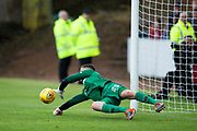 Dundee United goalkeeper Harry Lewis (#25) makes a save in the penalty shoot-out during the Betfred Scottish Cup group stage match between Dundee and Dundee United at Dens Park, Dundee, Scotland on 29 July 2017. Photo by Craig Doyle.