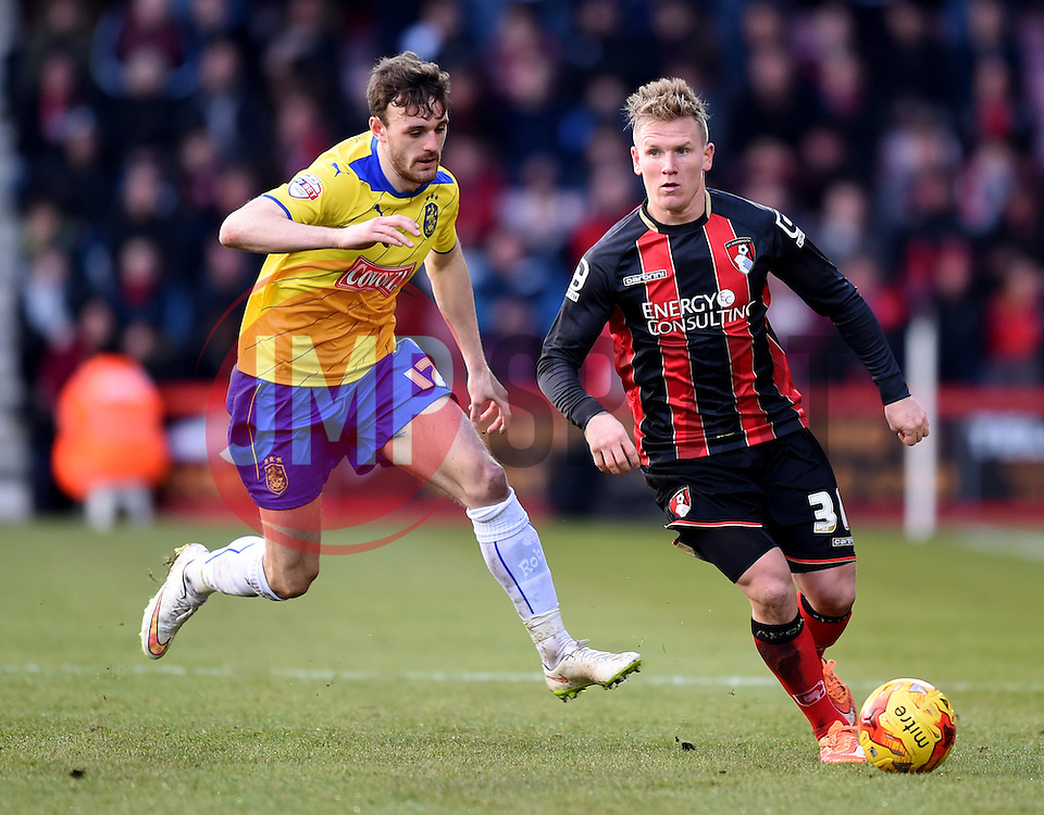 Huddersfield Town's Jack Robinson pursues Bournemouth's Matt Ritchie - Photo mandatory by-line: Paul Knight/JMP - Mobile: 07966 386802 - 14/02/2015 - SPORT - Football - Bournemouth - Goldsands Stadium - AFC Bournemouth v Huddersfield Town - Sky Bet Championship
