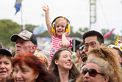 A young fan during the Glastonbury Festival at Worthy Farm in Pilton, Somerset. Picture date: Friday June 23rd, 2017. Photo credit should read: Matt Crossick/ EMPICS Entertainment.