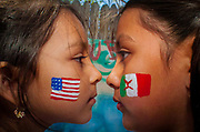 Natalia Dominguez, 5, left, and her older sister Valeria, 9, right, both of Greeley, pose for a portrait in the yard behind Al Frente de la Lucha community center, May 1, 2005.   Natalia was born in the U.S. but Valeria was born in Mexico.  During Monday's immigration rights march, Valeria asked her uncle, Fernando Lujan, also of Greeley, if being born in Mexico made her a criminal.