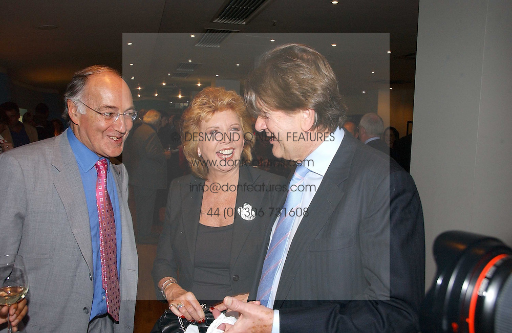 Left to right, MICHAEL HOWARD, tv presenter CILLA BLACK and JOHN MADEJSKI at a party to celebrate the publication of Glass Houses by Sandra Howard held at Tamesa, Oxo Tower Wharf, Barge House Street, London SE1 on 5th September 2006.<br />