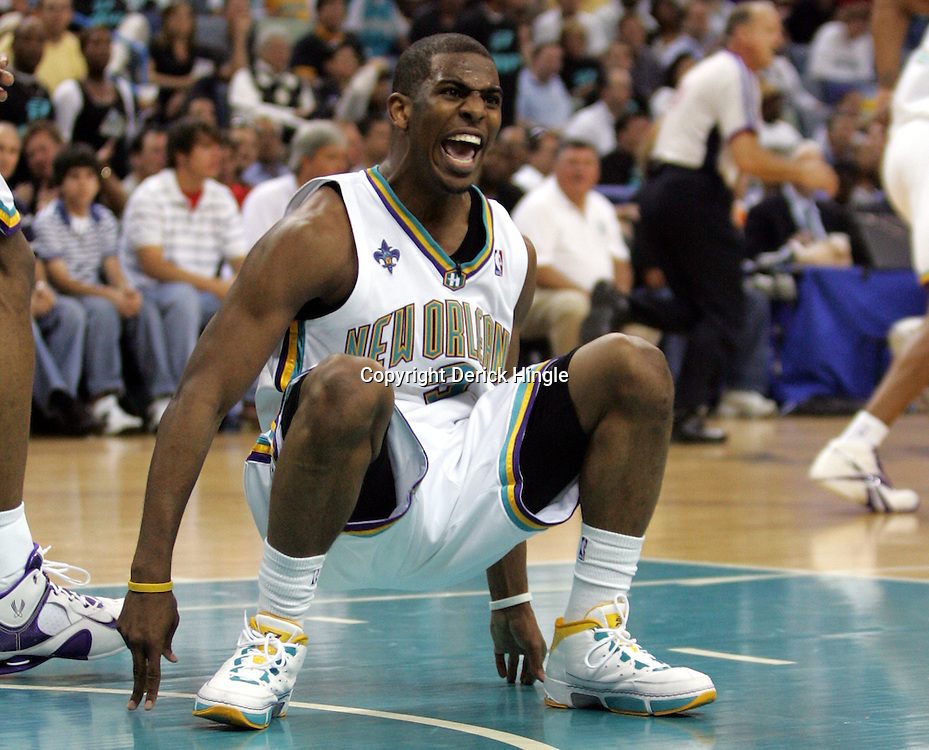 New Orleans Hornets guard Chris Paul #3 yells to an official after no call was made when he attempted to take a charge against the Golden State Warriors in the first half of their NBA game on April 6, 2008 at the New Orleans Arena in New Orleans, Louisiana.