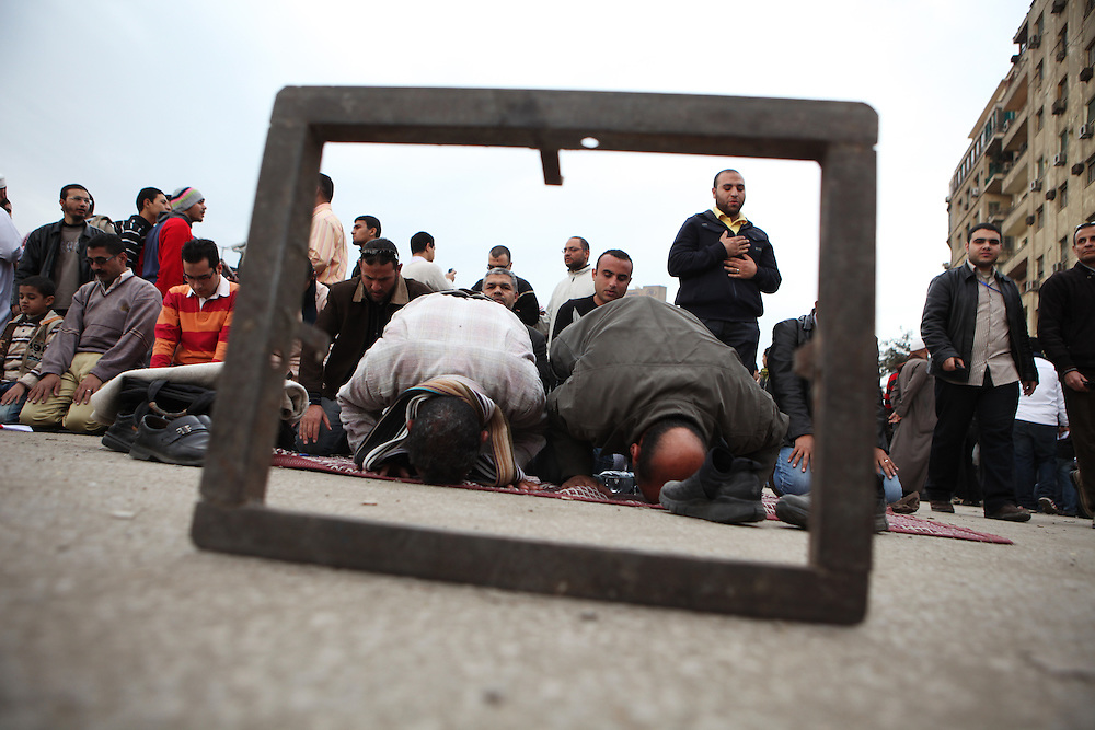"Egyptian Muslims pray on ""Sunday of the martyrs"" at Tahrir Square."