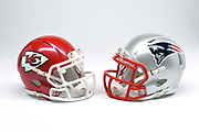 Detailed view of Kansas City Chiefs and New England Patriots helmets.