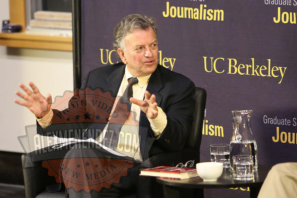 """Lowell Bergman speaks to James Risen during the """"Prosecuting the Press"""" event at the UC Berkeley Graduate School of Journalism in Berkeley, California, on Thursday, November 14, 2013. Risen, the New York Times national security reporter is facing jail for refusing to comply with a subpoena to reveal his sources in relation to his book titled State of War: The Secret History of the CIA and the Bush Administration. (AP Photo/Alex Menendez)"""