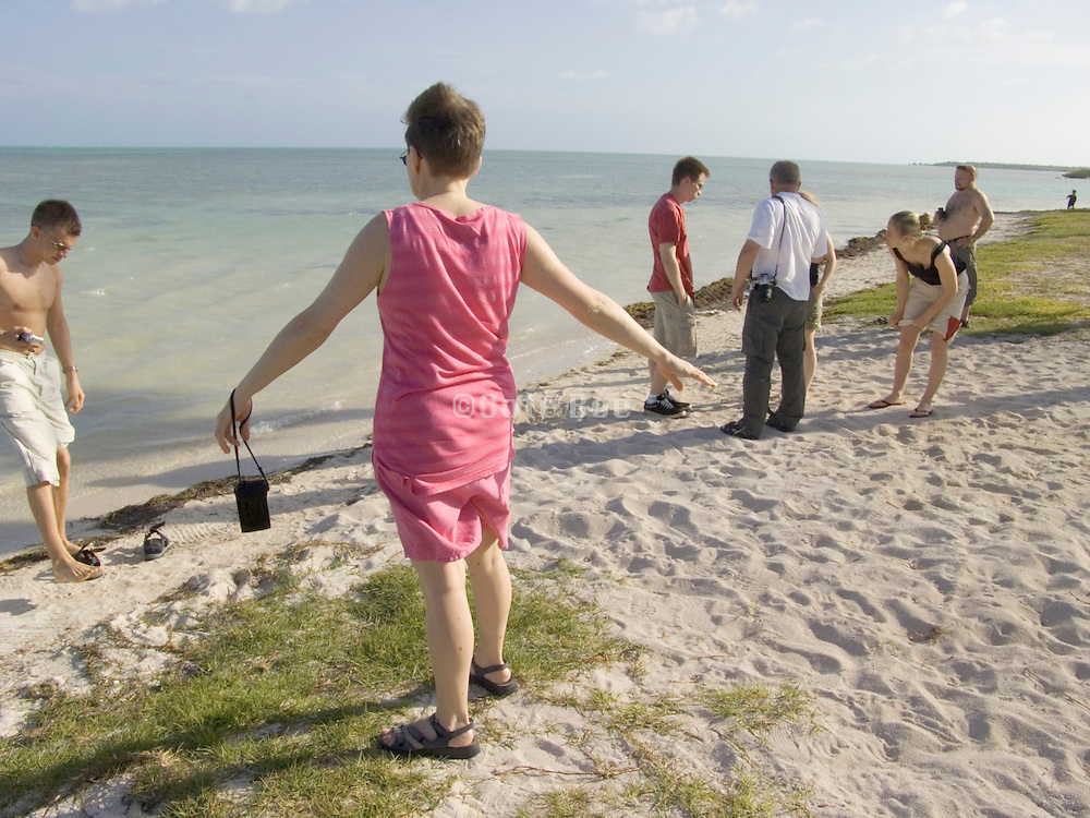 Group of tourist taking a break from driving route one between Key West and Key Largo