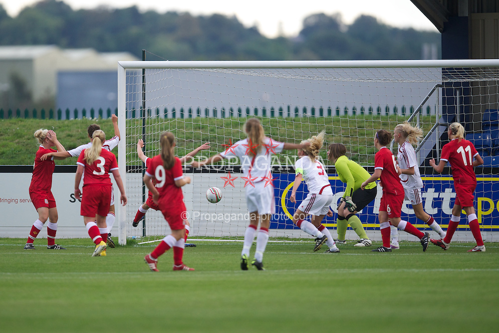 BROUGHTON, WALES - Friday, September 9, 2011: Denmark's captain Laura Larsen (Brondby IF) scores the first goal against Wales during an international friendly women's Under-17 match at the Airfield. (Pic by David Rawcliffe/Propaganda)