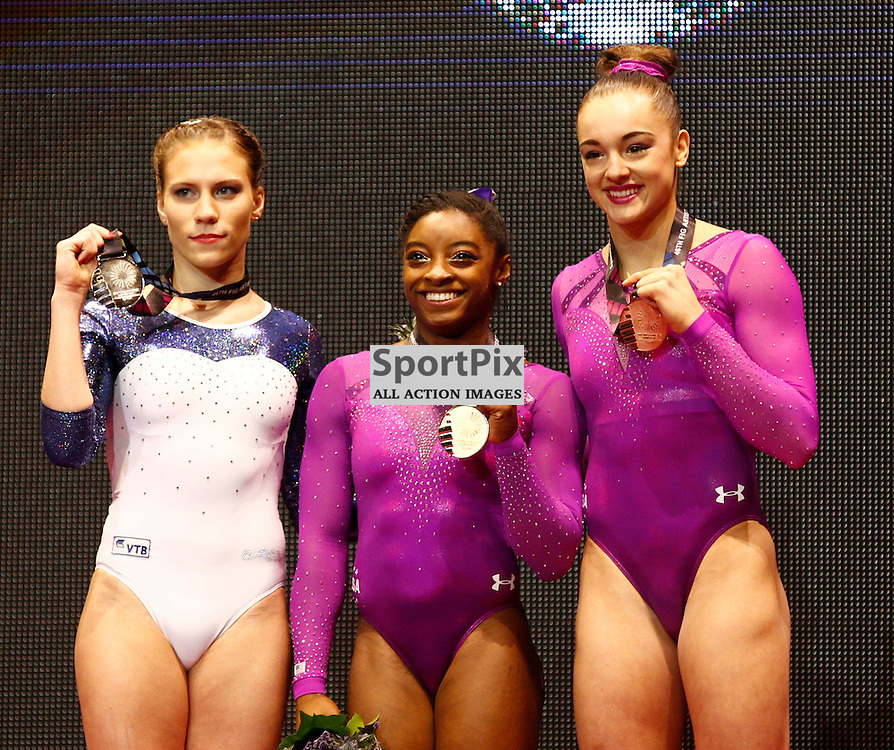 2015 Artistic Gymnastics World Championships being held in Glasgow from 23rd October to 1st November 2015.....L-R Kseniia Afanaseva (Russia) Silver medal, Simone Biles (USA) Gold medal winner & Margaret Nichols (USA) Bronze medal winner  in the Floor Exercise on Day 2 of the Women's & Men's Apparatus Final...(c) STEPHEN LAWSON | SportPix.org.uk
