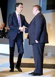 © Licensed to London News Pictures. 28/09/2011. LONDON, UK. Ed Miliband shakes the hand of Paul McKeever, Chairman of the Police Federation after Mr McKeever delivers a speech at The Labour Party Conference in Liverpool today (28/09/11). Photo credit:  Stephen Simpson/LNP