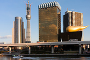 A motorboat passes the Tokyo Skytree under construction seen behind the  buildings of the Asahi Breweries Headquarters in Asakusa, Tokyo, Japan. Wednesday, December 29th 2010 When finished this telecommunications tower will measure 634 metres from top to bottom making it the tallest structure in East Asia..