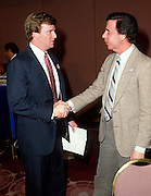 NFL executive and future NFL Commissioner Roger Goodell shakes hands with a member of the media during the 1987 NFL Draft on April 28, 1987 in New York, New York. ©Paul Anthony Spinelli