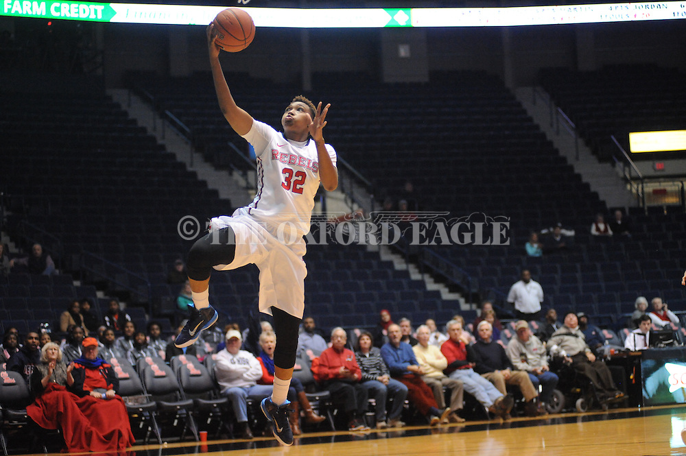 """Ole Miss Lady Rebels forward Tia Faleru (32) scores vs. Southern Mississippi at the C.M. """"Tad"""" Smith Coliseum in Oxford, Miss. on Thursday, December 18, 2014. (AP Photo/Oxford Eagle, Bruce Newman)"""