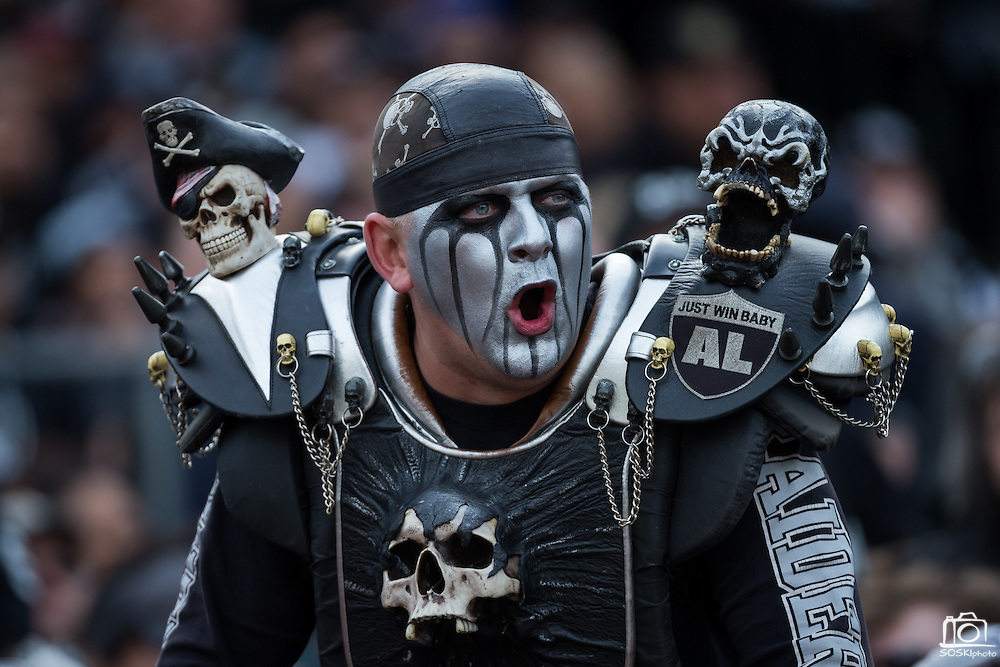 An Oakland Raiders fan cheers for his team during a NFL game against the Buffalo Bills at Oakland Coliseum in Oakland, Calif., on December 4, 2016. (Stan Olszewski/Special to S.F. Examiner)