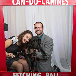 A girl lover her service dog at the Can DO Canines Fetching Ball fund raiser.