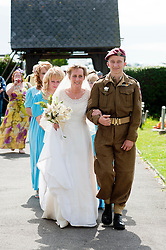 1940's Wedding Lytham The Bride Kath Plummer arrives at Saint John The Divine Church Lytham escorted by Son Adam Hacking.19 August 2011  Image © Paul David Drabble