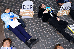 April 25, 2018 - Los Angeles, California, United States - People lying down in mock graves during Workers Memorial Day which honors workers who have been injured or killed on the job. Los Angeles, California on April 25, 2018. Workers, activists and labor organizers called on employers to improve working conditions and pay workers living wages. (Credit Image: © Ronen Tivony/NurPhoto via ZUMA Press)