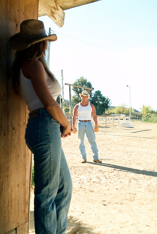 Lifestyle images of woman waiting at the door for her rancher husband to walk in.