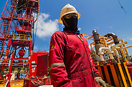 Worker on an oil rig, offshore of Vung Tau, Vietnam, Southeast Asia