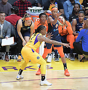 Connecticut Sun guard Jasmine Thomas (5) signals to team mates as Los Angeles Sparks guard Riquna Williams (2) defends during a WNBA basketball game, Friday, May 31, 2019, in Los Angeles.The Sparks defeated the Sun 77-70.  (Dylan Stewart/Image of Sport)