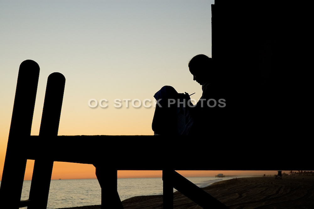 Silhouette of a Girl Studying on Lifeguard Tower in Newport Beach