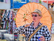 The sun comes back out and umbrellas/parasols return. The 2015 Glastonbury Festival, Worthy Farm, Glastonbury.