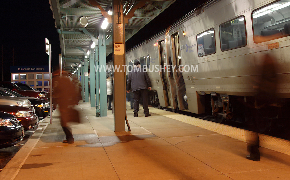 Town of Wallkill, N.Y. - Passengers walk away from their commuter train at the Metro North train station on the evening of Feb. 25, 2008.