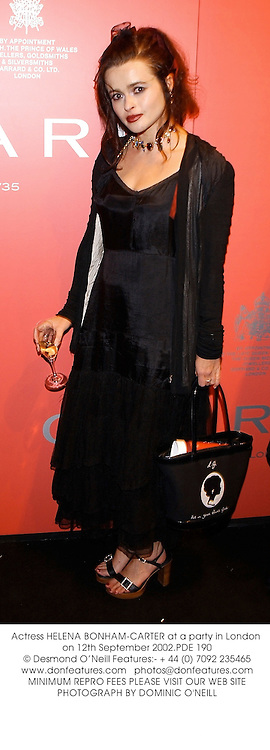 Actress HELENA BONHAM-CARTER at a party in London on 12th September 2002.PDE 190