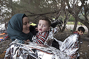 Nov. 16, 2015 - Lesbos, Greece - <br /> A Syrian mother wrapped with an emergency blanket holds her child after she reached the shores of the Greek island of Lesbos after crossing the Aegean Sea from Turkey on November 16, 2015. Since the start of the summer, the Greek island of Lesbos has assumed notoriety as the main gateway into Europe for thousands of desperate refugees that continue to cross the Aegean sea from Turkey every day. <br /> ©Exclusivepix Media